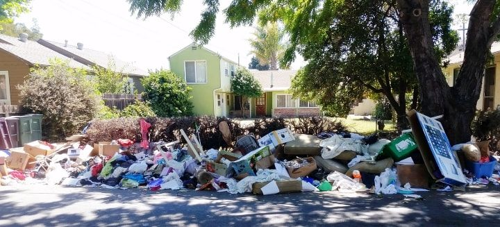 Trash hauling service for junk left by tenant in San Leandro
