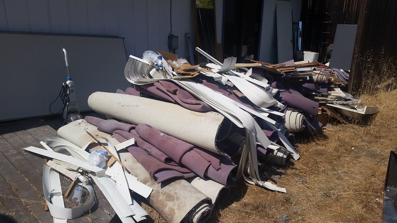 Rolls of carpet hauled away by West Coast Junk