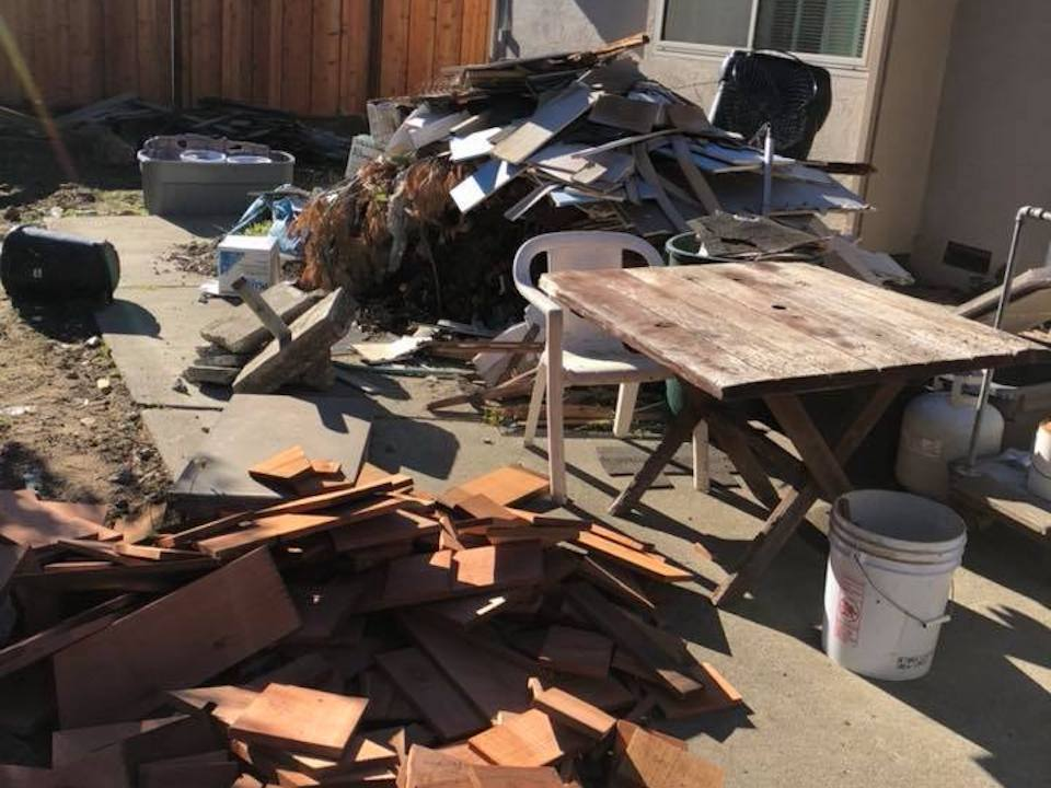 construction debris taking up the entire backyard patio, Oakland, CA