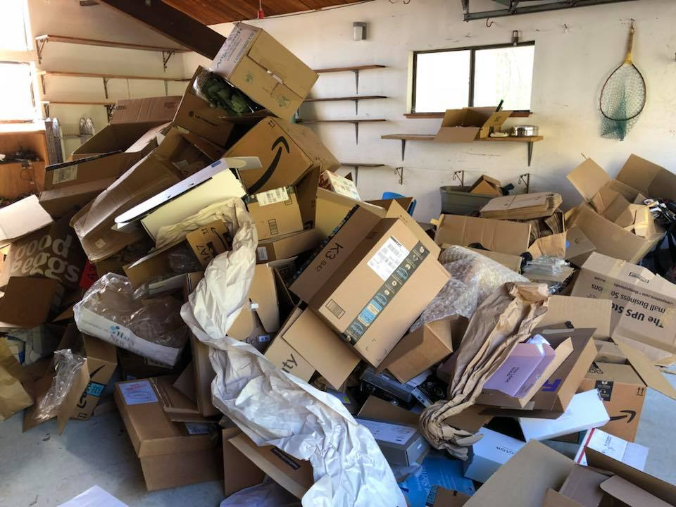 Garage full of cardboard boxes in Brisbane, CA - hauled away and responsibly recycle junk by West Coast Junk