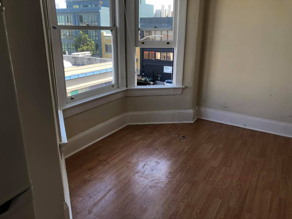 After: Moving Junk cleared out of San Francisco Apartment, swept floor, ready for fresh paint and a new tenant!