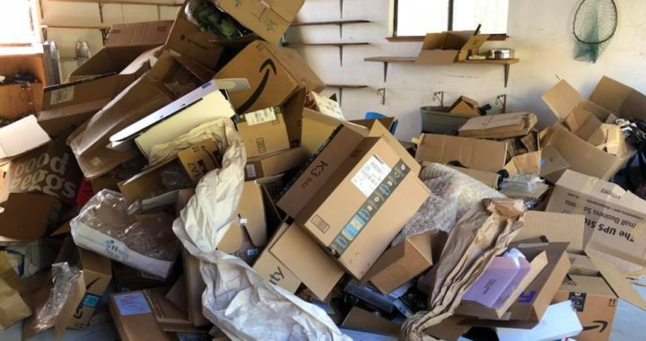 Garage full of cardboard boxes in Brisbane, CA - hauled away and responsibly recycled by West Coast Junk